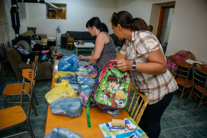 Albania: Women part of mercy ministry prepare new backpacks, clothes, and shoe supplies for Roma children apart of the Mercy ministry.  Photo by Garrett N More Info
