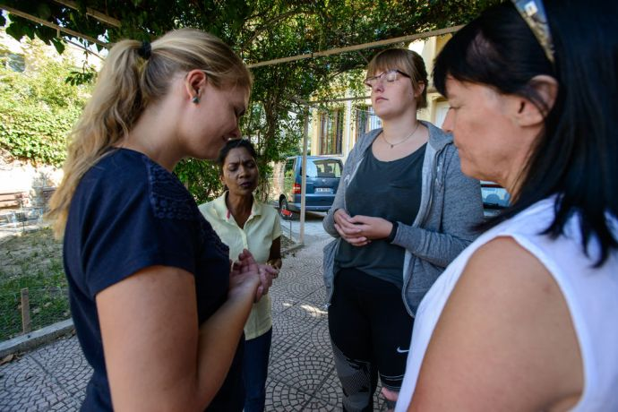 Albania: Women apart of mercy ministry pass out backpacks filled with school supplies and clothes to Roma children.  Photo by Garrett N More Info