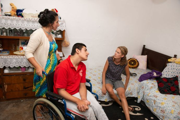 Albania: Through mercy ministries, this special needs young man is able to get the help needed to learn basic skills through the house visit of a local worker.  Photo by Garrett N More Info