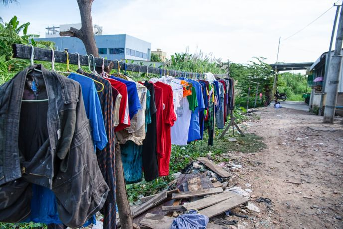 Cambodia: Clothes hanging out to dry in a poor village. More Info