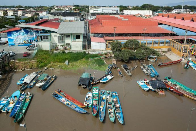 Ecuador: Guayaquil, Ecuador :: Small fishing boats dock close to Logos Hopes quayside on the Guayas River. More Info