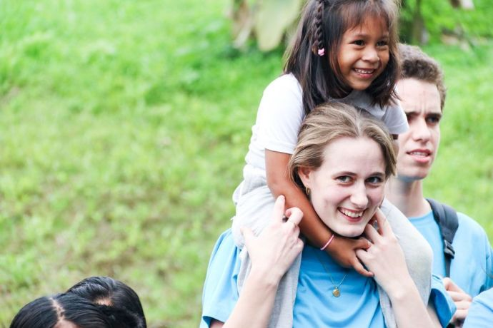 Ecuador: Guayaquil, Ecuador :: Miriam Lange (Denmark) befriends a young girl during a day of outreach in a rural community. More Info
