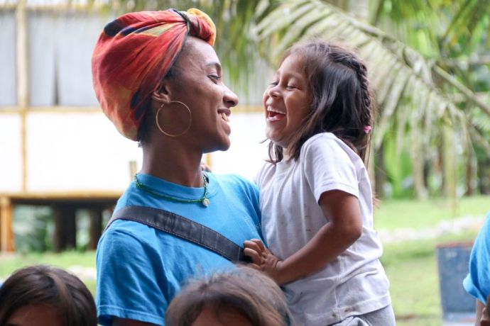 Ecuador: Guayaquil, Ecuador :: Jessica Brown (Jamaica) connects with a young girl during a day of outreach in a rural community. More Info