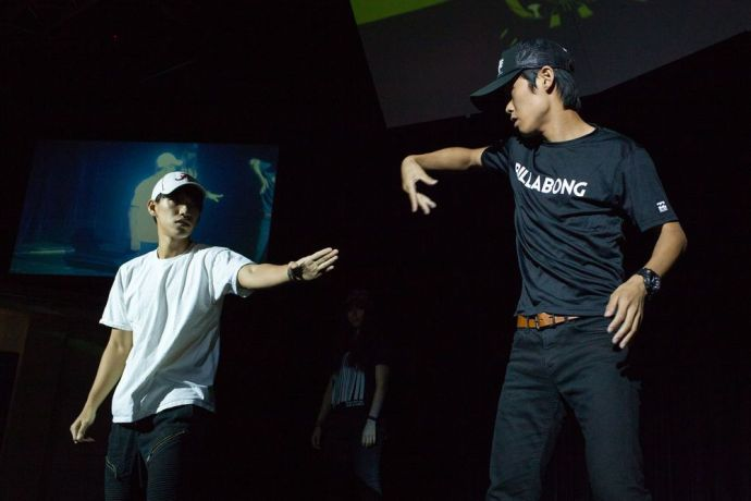 Ecuador: Guayaquil, Ecuador :: Abram Gim (South Korea) and Jun Nukada (Japan) perform a hip hop routine during an onboard event. More Info
