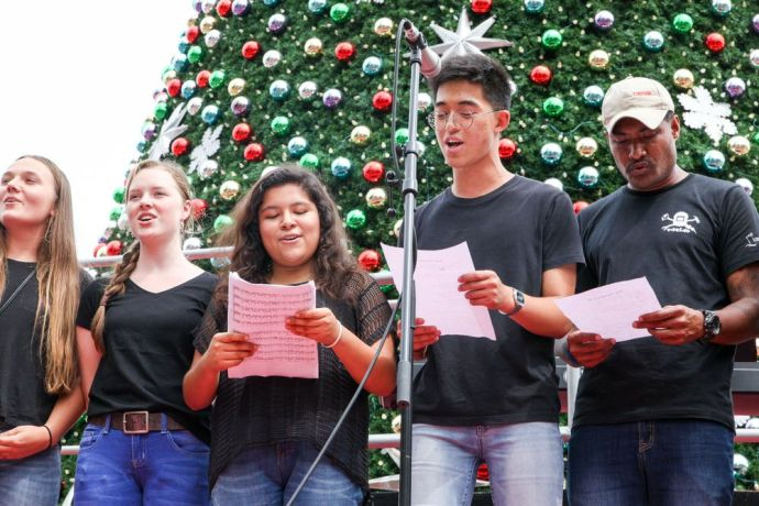 Ecuador: Guayaquil, Ecuador :: Crewmembers including DongHyeok Kang (South Korea) sing as part of a choir during an open air cultural event held by crewmembers from Logos Hope. More Info