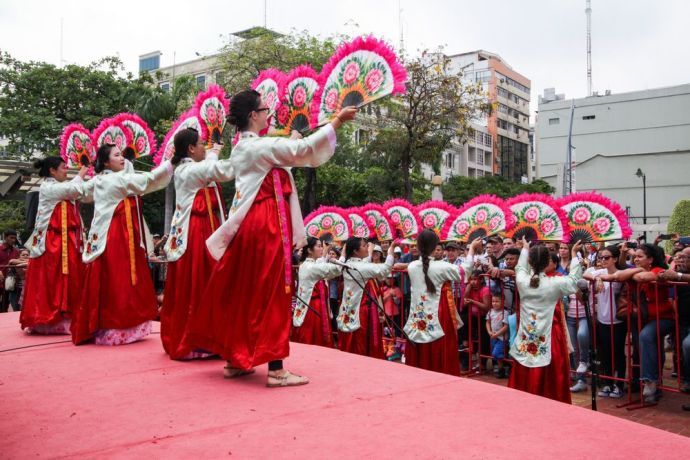 Ecuador: Guayaquil, Ecuador :: Crewmembers from Logos Hope perform a traditional Korean dance at an open air cultural event. More Info