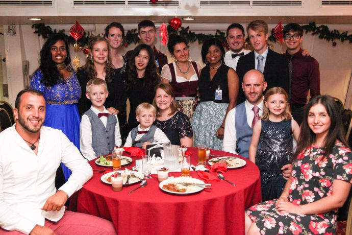 Ecuador: Guayaquil, Ecuador :: Crewmembers enjoy Christmas dinner together on board. More Info