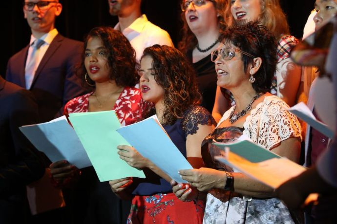 Ecuador: Guayaquil, Ecuador :: Suzie Potter (USA), Ester Lugao (Brasil) and Erica Thakurdin (Barbados) sing Christmas carols at a service on board Logos Hope. More Info