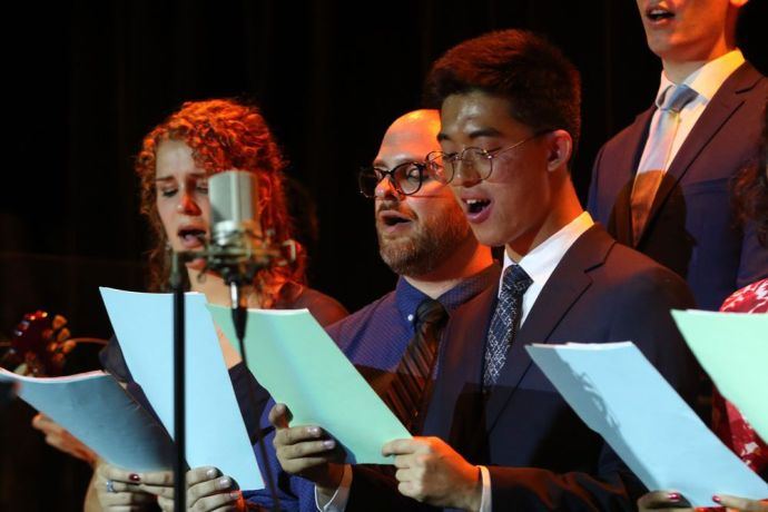 Ecuador: Guayaquil, Ecuador :: Rhode Weekhout (Argentina), Mike Roten (USA) and DongHyeok Kang (South Korea) sing Christmas carols at a service on board Logos Hope. More Info