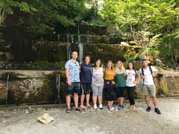 Albania: A first outreach team of Journey to the North (a travelling discipleship ministry) poses by a waterfall in northern Albania. More Info