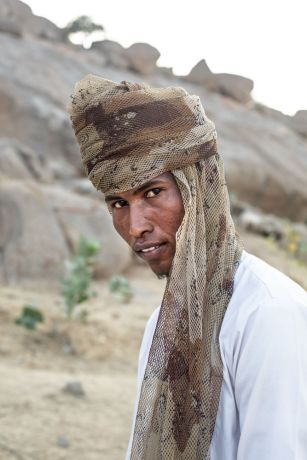 Africa: Man poses to get his portrait taken in central north Africa. Photo by Rebecca Rempel More Info