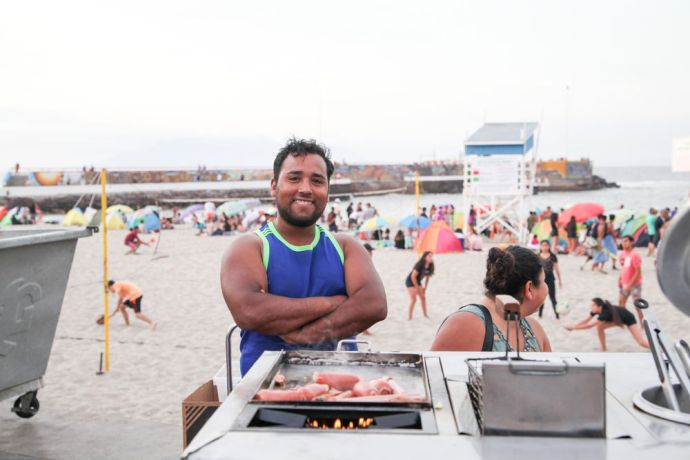 Chile: Antofagasta, Chile :: A man sells street meat on the beachfront. More Info
