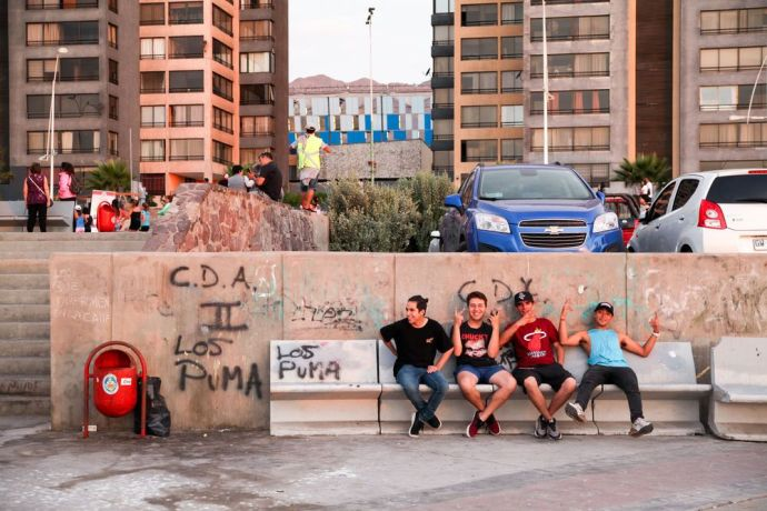 Chile: Antofagasta, Chile :: Teenagers hang out at the beachfront. More Info