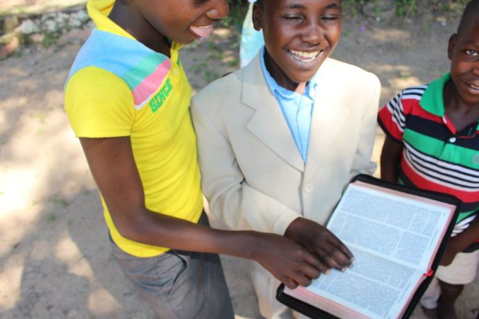 Zimbabwe: Three boys read the story of Jonah for themselves as after hearing it being told by their teacher at school. More Info