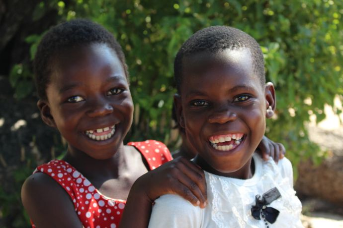 Zimbabwe: After a church service, these young girls asked to have their picture taken so they could show a smile to the world. More Info