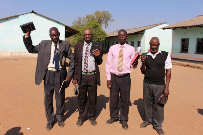Zimbabwe: These men are part of the church of leadership but none of them had a Bible till OM gave to them. More Info