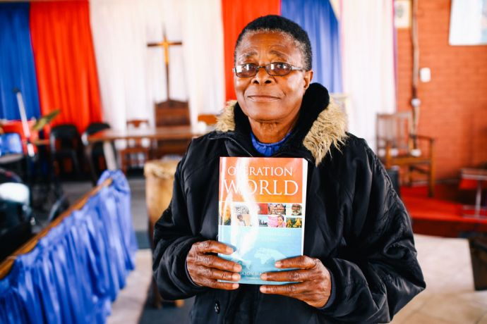 Zimbabwe: OM Zimbabwes Discipleship Journey trainee shows her Operation World book, She uses this book for her prayer time. More Info