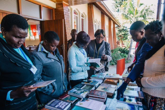 Zimbabwe: GO Challenge Participant purchases a book from the OM book stand More Info