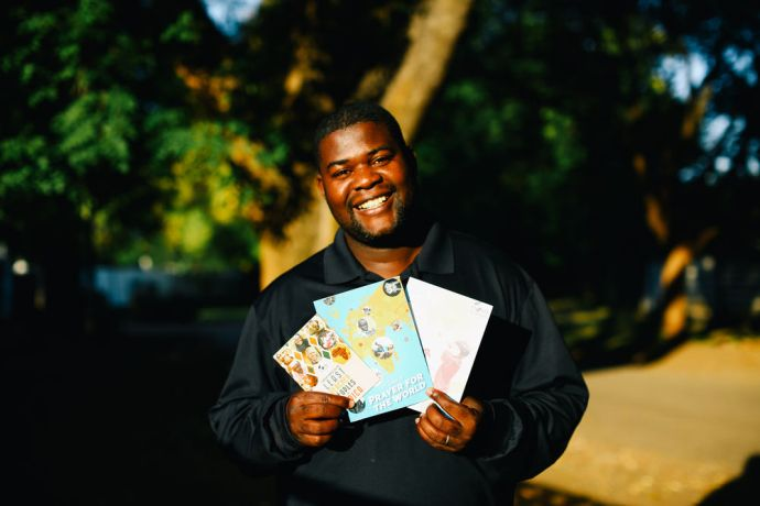 Zimbabwe: OM Zimbabwes writer Simon Marijani shows his prayer guide book. More Info