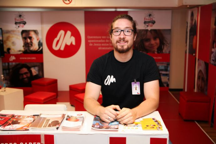 Chile: Valparaiso, Chile :: Roberto Espinoza (OM Chile) waits at the OM LAM booth on Logos Hope, ready to speak to any visitors who are interested in missions or the least reached. More Info