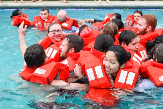 Chile: Valparaiso, Chile :: New recruits practice using life jackets as part of their pre-ship safety training. More Info