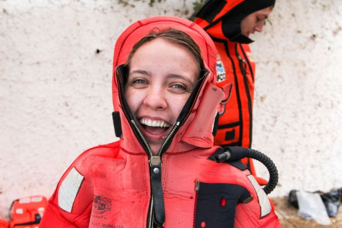 Chile: Valparaiso, Chile :: Esther Ehlert (Brazil) practices wearing an immersion suit as part of her pre-ship safety training. More Info