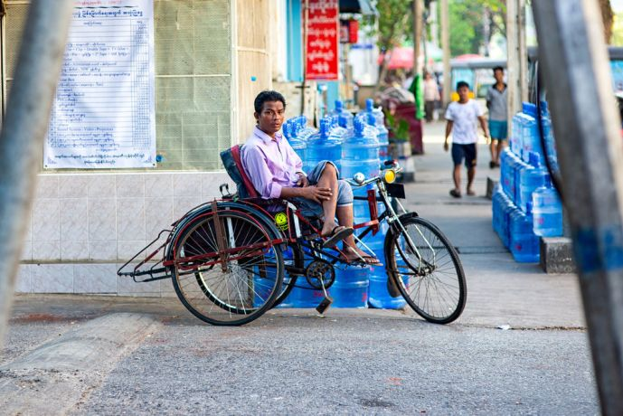 Myanmar: In a city where motorbikes are not allowed transportation by bicycle is very common. This man is taking a break on his bike during the hotter part of the day. More Info