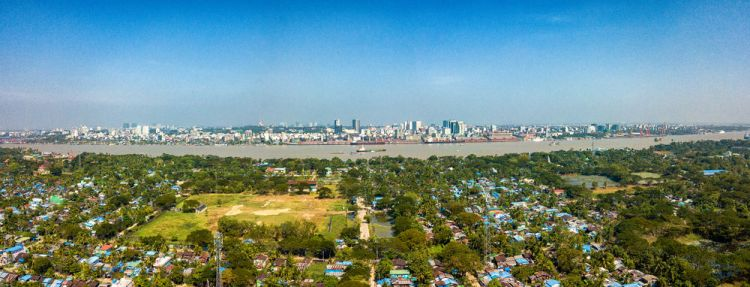 Myanmar: A view over the river and the cityscape of Yangon. More Info