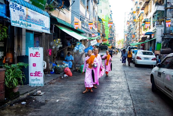 Myanmar: Every day Buddhist monks will leave the temples and walk around the city collecting donations. More than just a religious establishment, the Buddhist Temples provide social support and care for their surrounding neighborhoods as the government does not have any such institutions. More Info