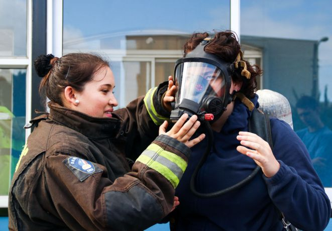 Chile: Lirquén, Chile :: Anita Khatcherian (Argentina) try a oxygen mask during a fire training. More Info