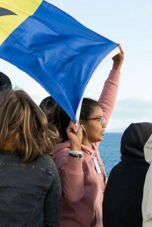 Chile: Punta Arenas :: Erika Thakurdin (Barbados) wait the ships arrival on the deck 9. More Info