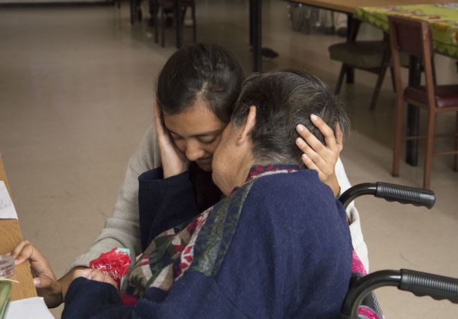 Chile: Lirquén, Chile :: Aurora Dorantes (Mexico) hugs an elderly resident at a care home. More Info