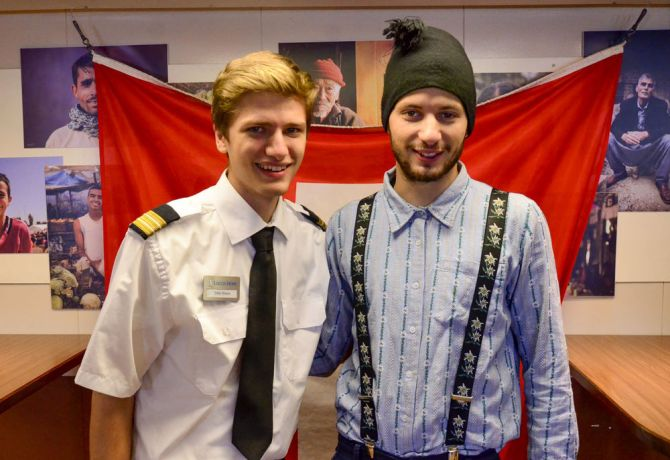 Chile: Punta Arenas, Chile :: Silas Boesh and Fabian Indermaur (Switzerland) welcome visitors on European Day on board Logos Hope. More Info