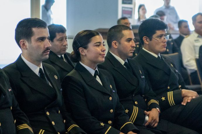 Chile: Punta Arenas, Chile :: Chilean naval personnel listen as crewmembers recount the story of the shipwreck of Logos. More Info