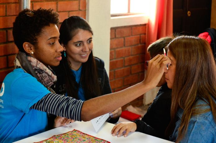 Chile: Punta Arenas, Chile :: Jessica Brown (Jamaica) tests a womans eyesight. More Info