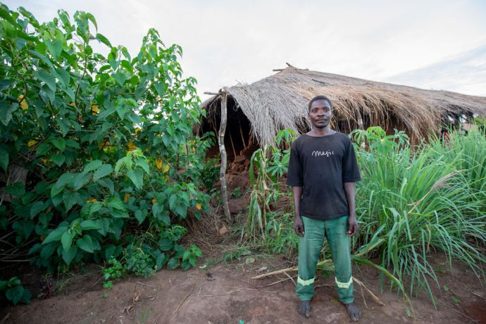 Mozambique: A man stands in front of his home that was damaged by the heavy rain and winds of Cyclone Idai in Mozambique. Photo by Rebecca Rempel More Info