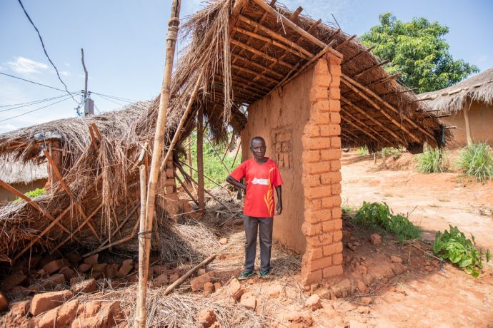 Mozambique: An elder stands in a home in his village that was damaged by the heavy rain and winds of Cyclone Idai in Mozambique. Photo by Rebecca Rempel More Info