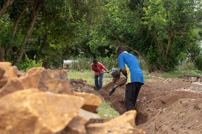 Mozambique: Men work to dig the foundation of a house on the OM base in Mozambique. Photo by Rebecca Rempel More Info