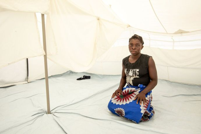 Mozambique: Amina, a widow and mother of five, by her tent. Aminas house, which used to be by the river, was destroyed by Cyclone Idai in Mozambique. She and her family have moved to a tent provided by the government on the outskirts of town. Photo by Rebecca Rempel. More Info