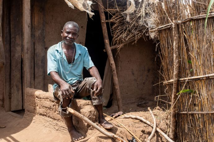 """Malawi: """"I didn't expect the house would collapse like this,"""" said Chatayika, a subsistence farmer in Malawi, as he looked at the home where he lived with his wife and six children. After three days straight of rain from Cyclone Idai Chatayika discovered that the walls of the house were wet inside and outside and decided that his family needed to move out. The house collapsed once they had exited. The family is staying in a thatched hut till rainy season ends and they can rebuild. Photo by Rebecca Rempel More Info"""