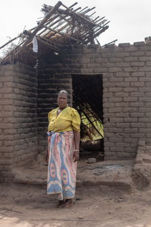 Malawi: Sarah lives on the same property as three of her daughters—each of them in their own house. In one night, all three of the daughters' houses collapsed from the strong rain and winds of Cyclone Idai in Malawi. The daughter's moved into Sarah's house, but her house suffered damage as well and there are now cracks in the walls and foundation. Photo by Rebecca Rempel More Info