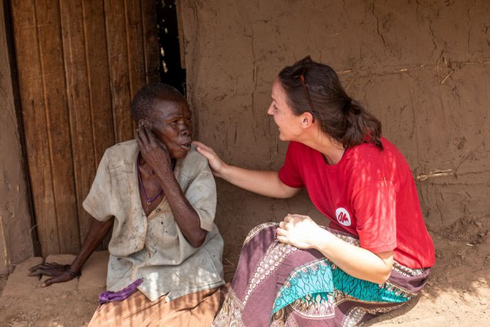 Malawi: An OM worker talks with a woman whose house was destroyed by Cyclone Idai. Photo by Rebecca Rempel More Info