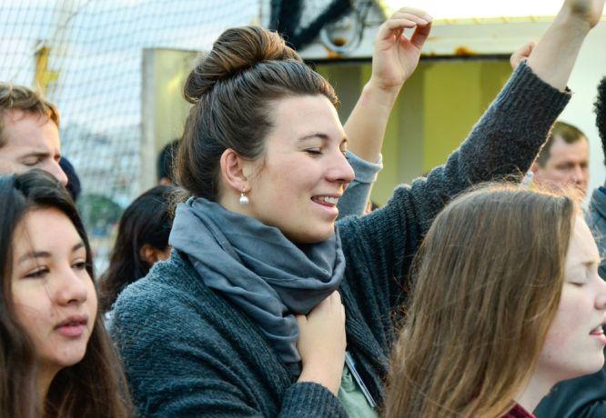 Uruguay: Montevideo, Uruguay :: Roselyn Faensen-Glienke (Germany) worships during the Easter Sunday service on Logos Hopes top deck. More Info