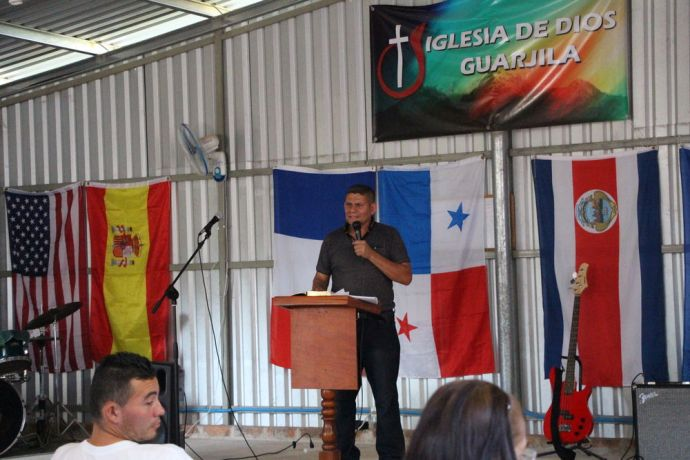 El Salvador: One of the teams member sharing the word at a local Church More Info