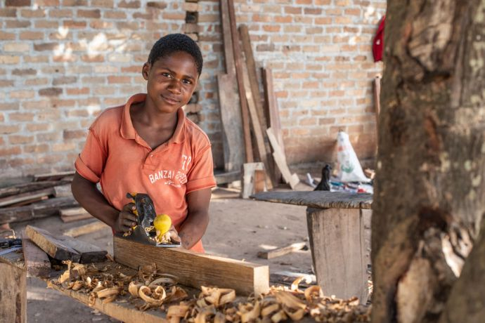 Mozambique: A boy does carpentry in Mozambique. Photo by Rebecca Rempel More Info