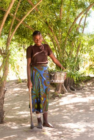 Malawi: A woman poses for a photo after coming in from the fields in Malawi. Photo by Rebecca Rempel More Info