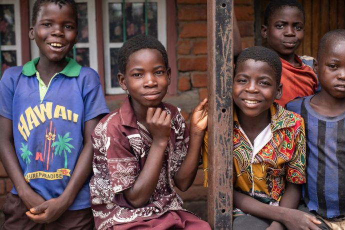Malawi: Boys pose for a photo in a village in Malawi. Photo by Rebecca Rempel More Info