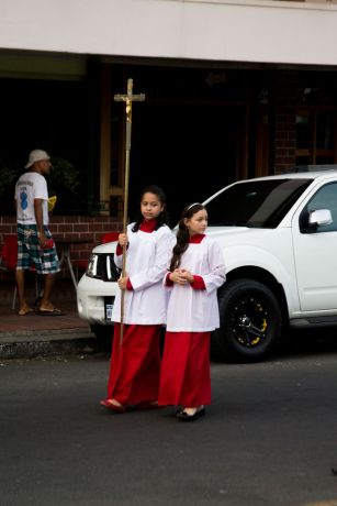 Panama: Two girls holding a cross during a Catholic march in Herrera, Panama. More Info