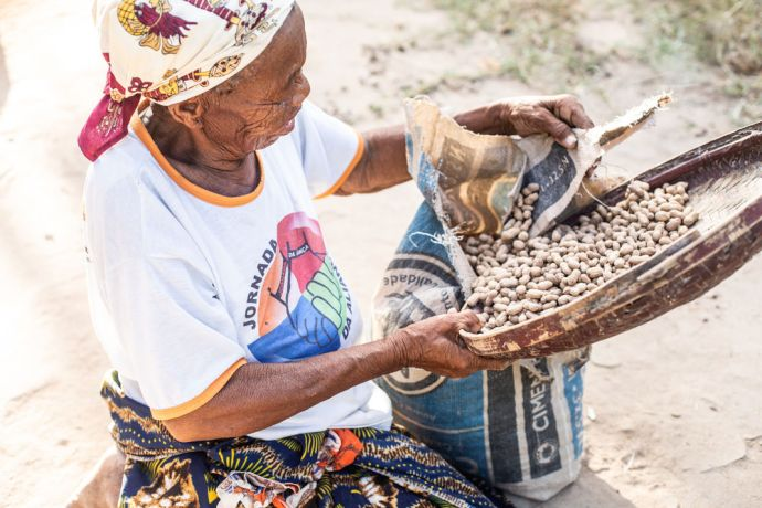 Mozambique: A woman sorts through ground nuts in a village in Mozambique. Photo by Rebecca Rempel More Info