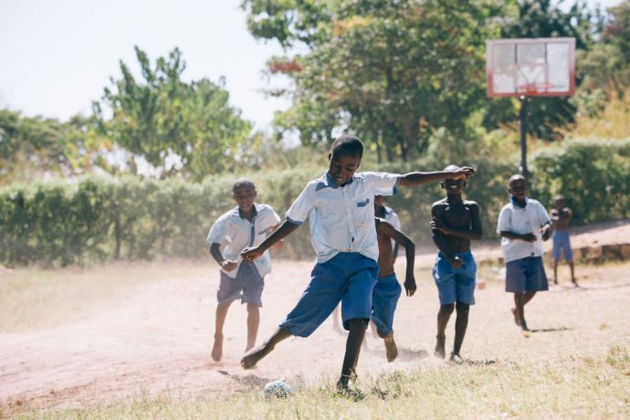 Zambia: Good News II School students play football at the playground. Mpulungu, Zambia More Info